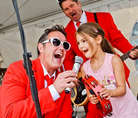 Band singing with child